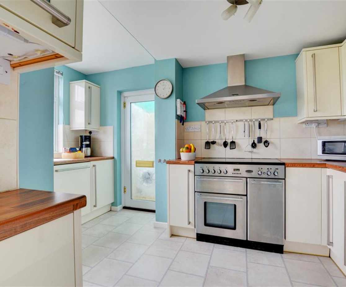 The modern and well equipped kitchen has a useful utility area which leads onto the terrace
