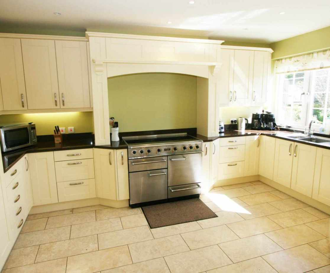 The kitchen/dining room is a large open plan L-shape room
