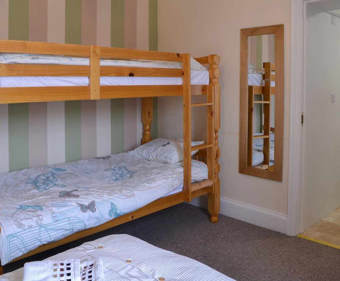 Double bedroom with additional bunk beds and en-suite