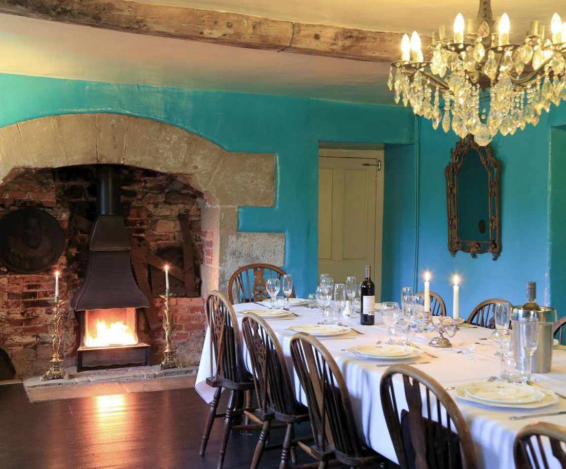 Wood burning stove in the dining room's fireplace