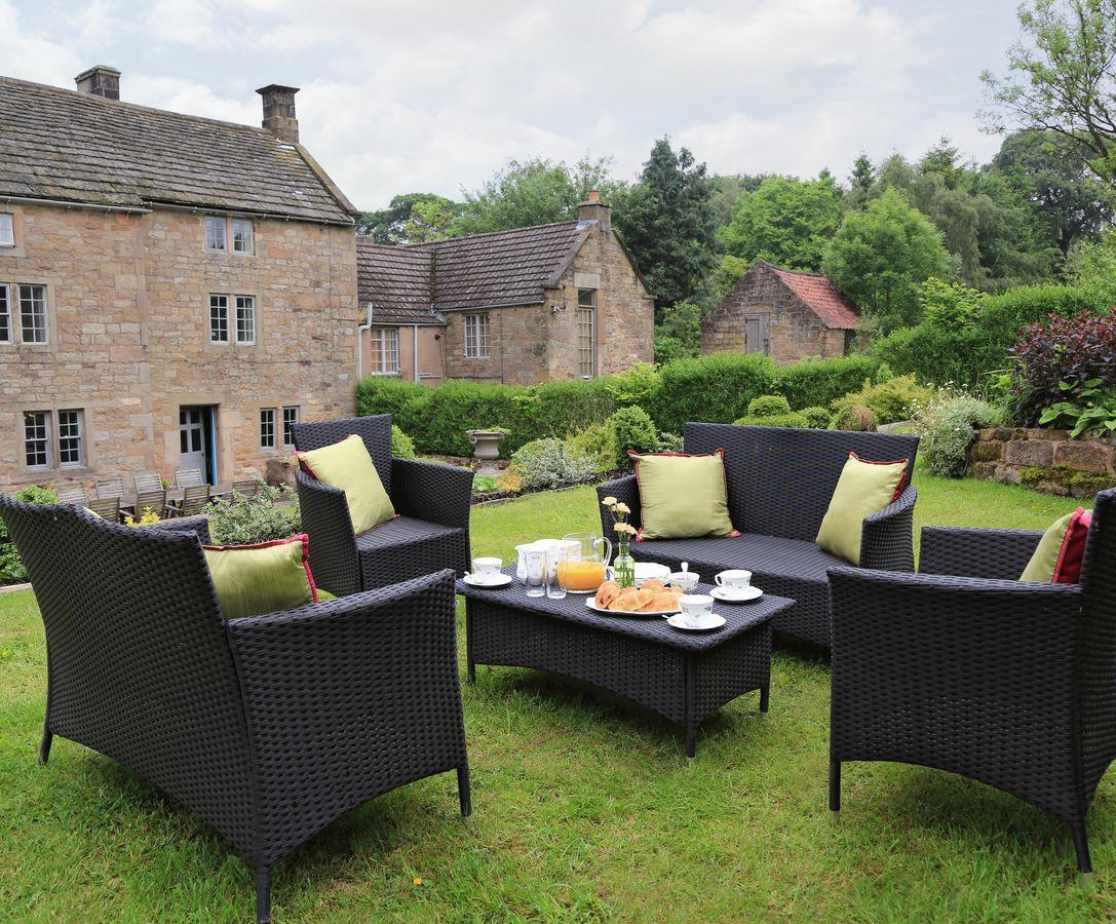 Outdoor furniture on an upper lawn
