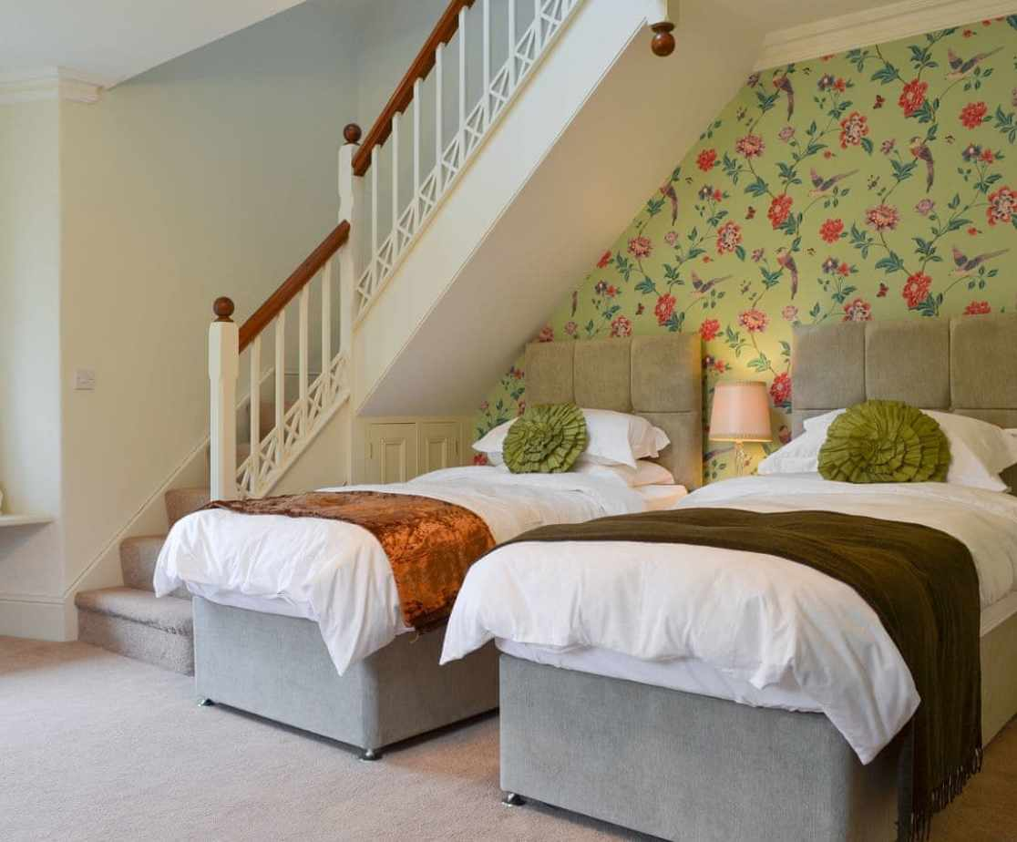Twin bedroom with access to additional double bedroom and en-suite