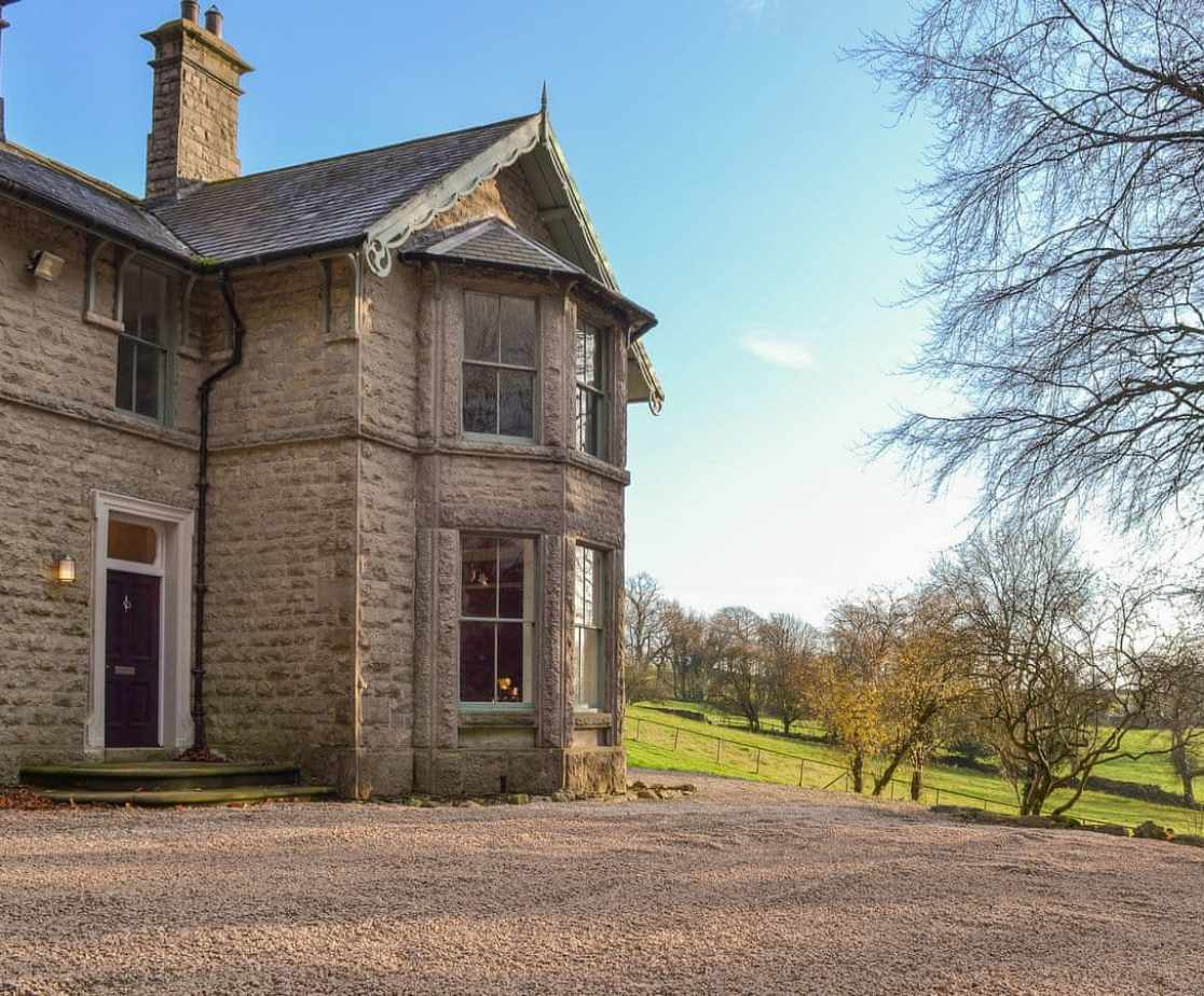 A sweeping gravelled drive and ample parking